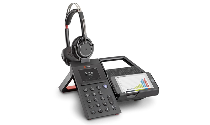 Image of a Poly Elara 60 WS Smartphone Dock with a Voyager Focus headset with a smartphone in landscape orientation.